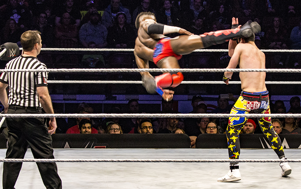Cedric Alexander delivers a flying kick to the head of TJP.